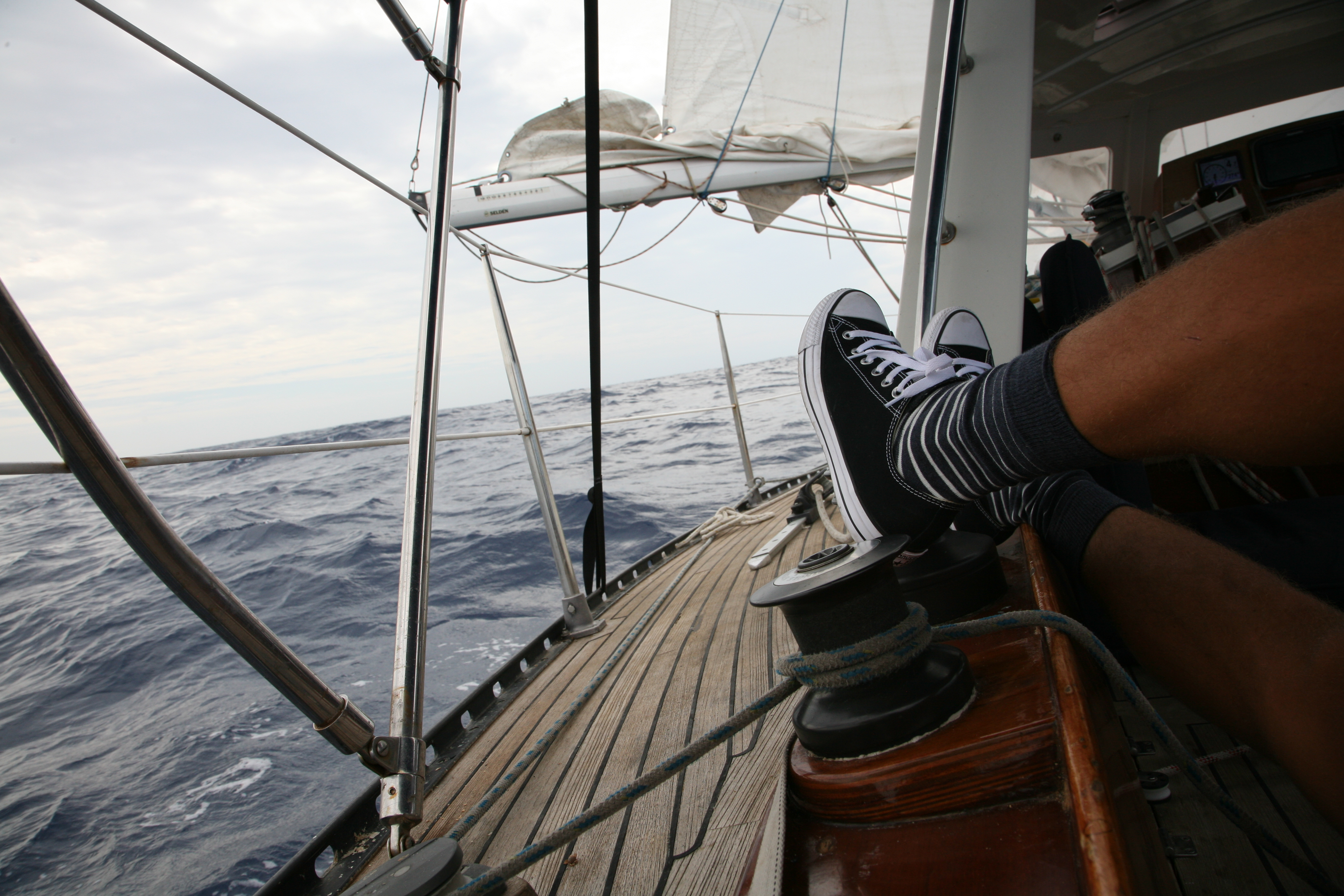 Sneakers on a sail boat.