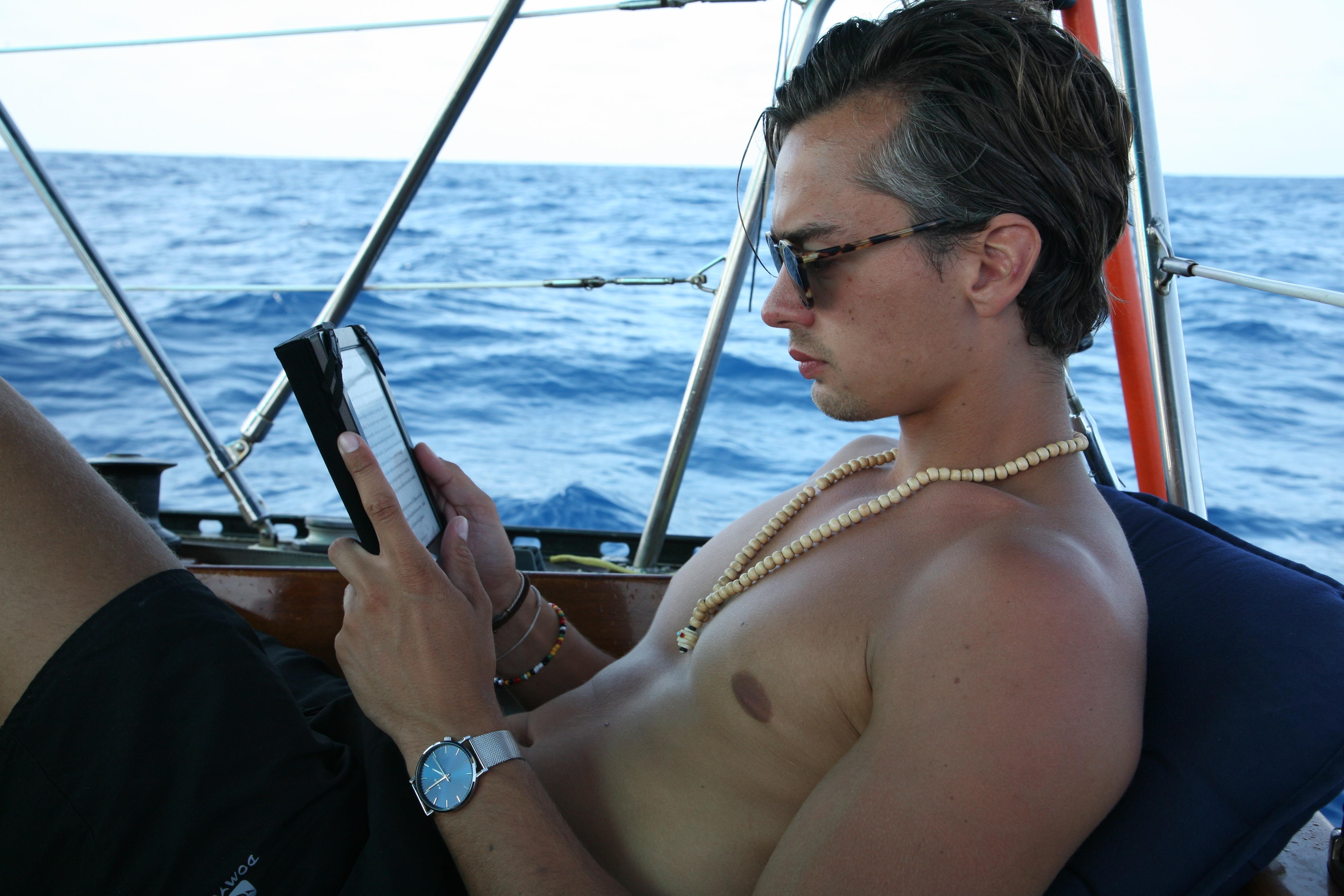 Hilmar having a read onboard the 'Anne Marie'.