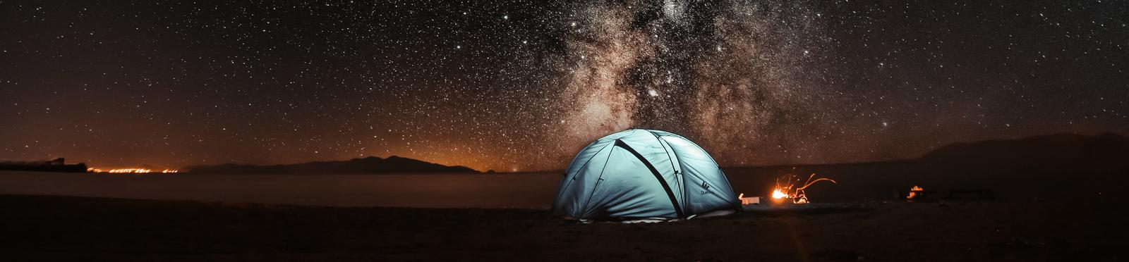 Adventurous spot with a tent under the sky full of stars