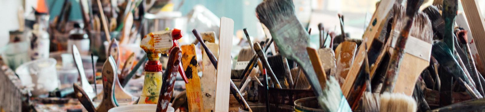 Painting Studio filled with brushes.