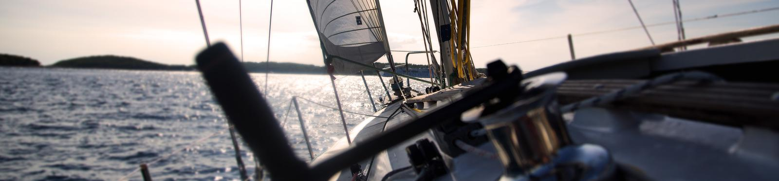 The view of a sailer from his perspective, sailing the waters.