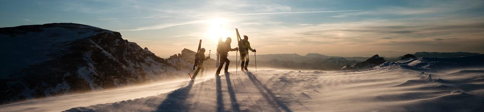 Skiers on a mountain top.