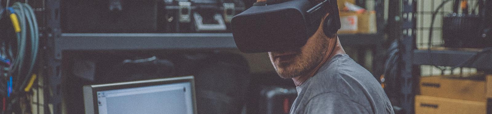 A guy with a virtual reality glasses on his head.
